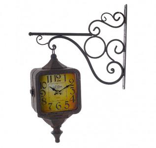 Часы на кронштейне старинные