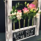 Композиция в колбе С Новым годом розы